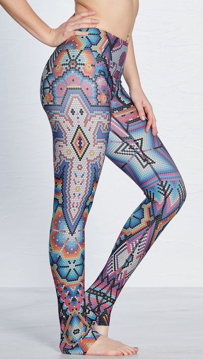close up right side view of model wearing purple beaded lizard themed printed full length leggings