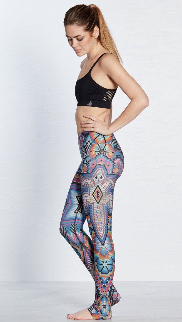 left side view of model wearing purple beaded lizard themed printed full length leggings