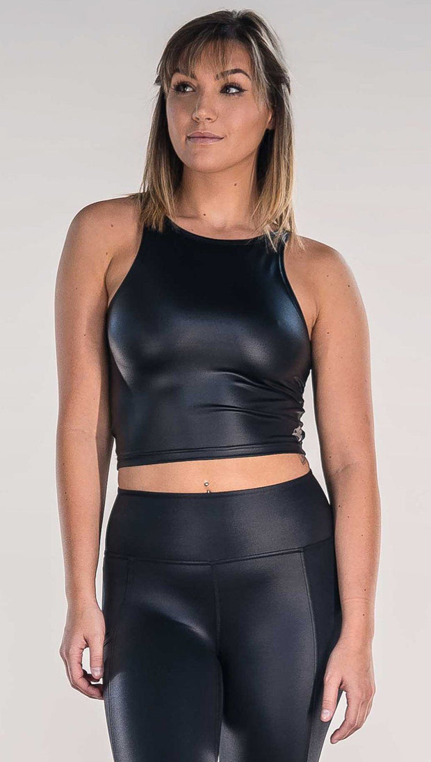 Front view of model wearing shiny black sleeveless top