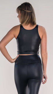 back view of model wearing shiny black sleeveless top