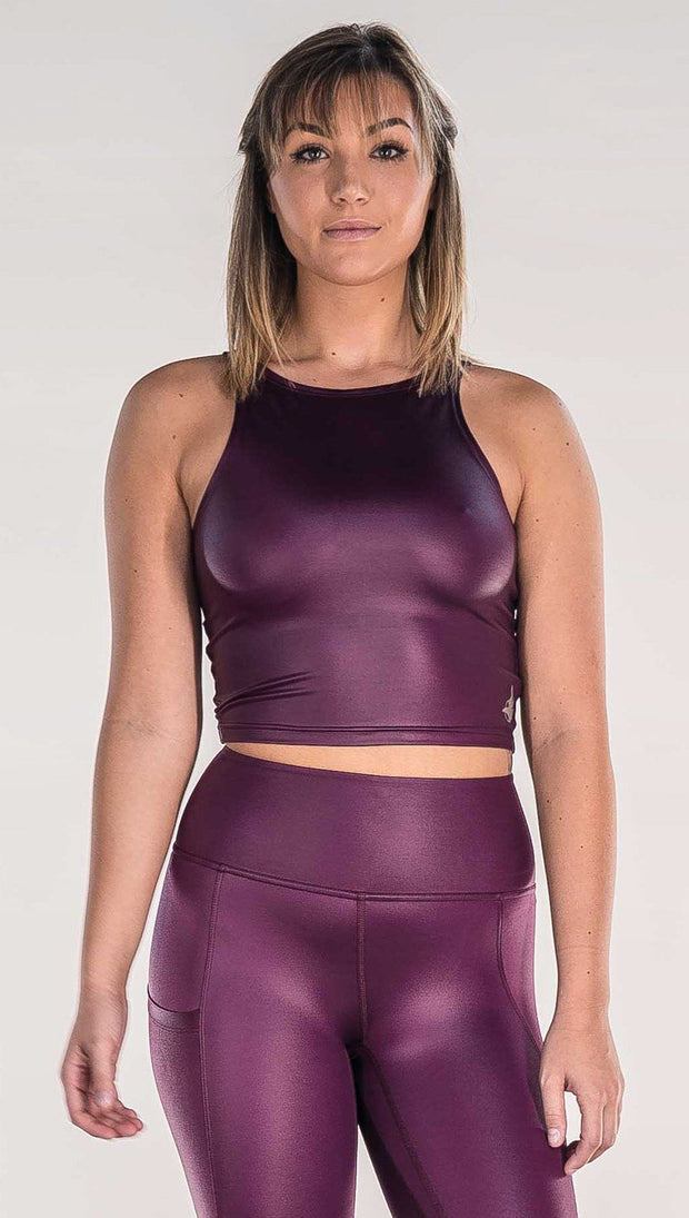 front view of model wearing shiny eggplant purple sleeveless top
