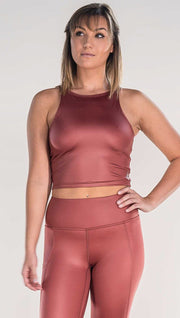 Front view of model wearing shiny mauve colored sleeveless top