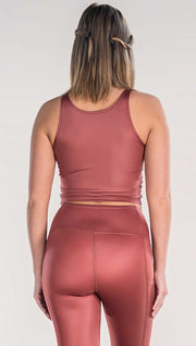 Back view of model wearing shiny mauve colored sleeveless top