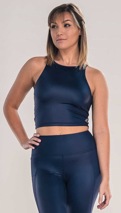 Front view of model wearing shiny midnight blue sleeveless top