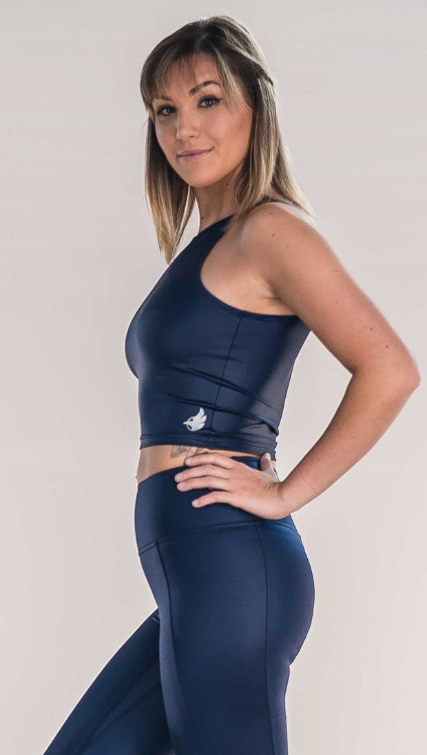 Side view of model wearing shiny midnight blue sleeveless top