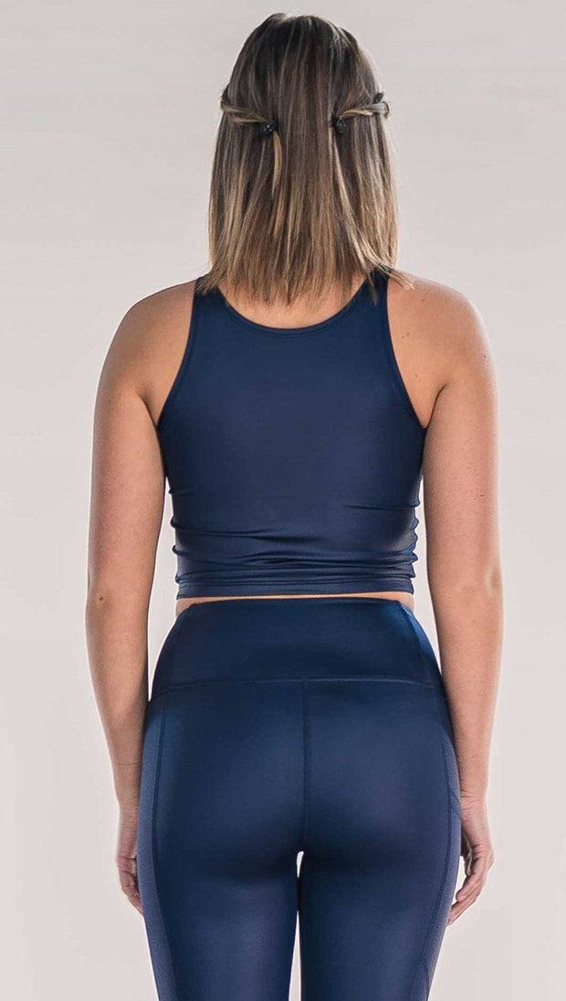 Back view of model wearing shiny midnight blue sleeveless top