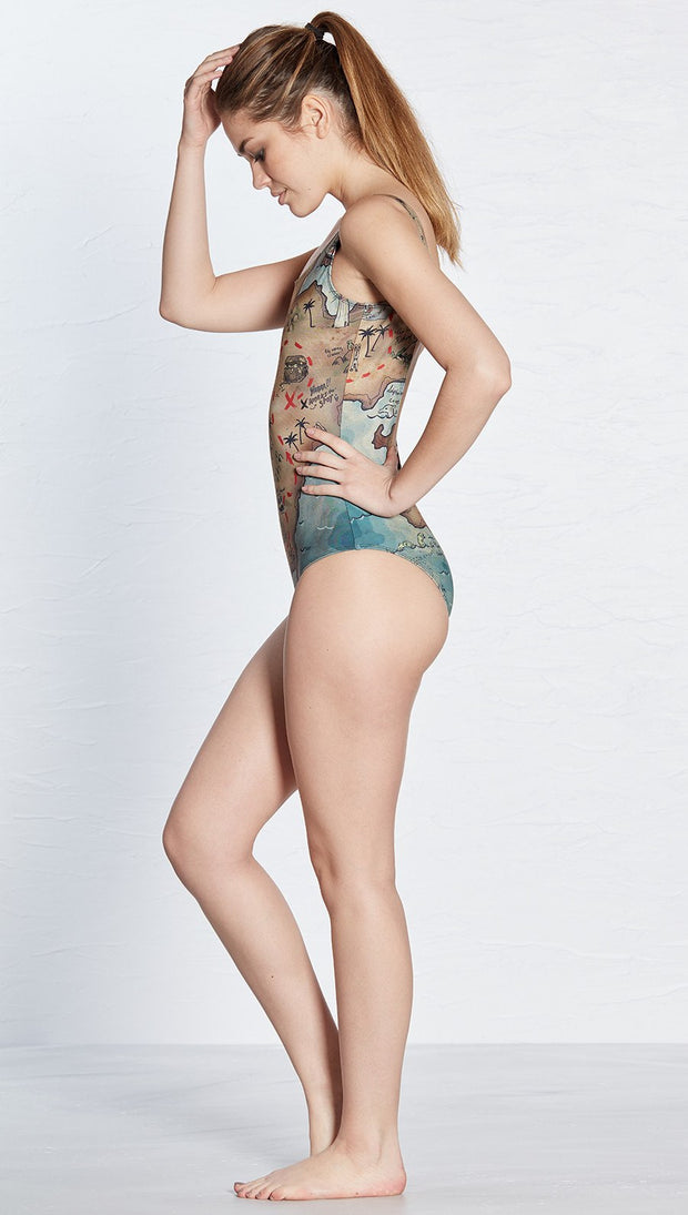 left side view of model wearing pirate treasure map themed one piece swimsuit / leotard