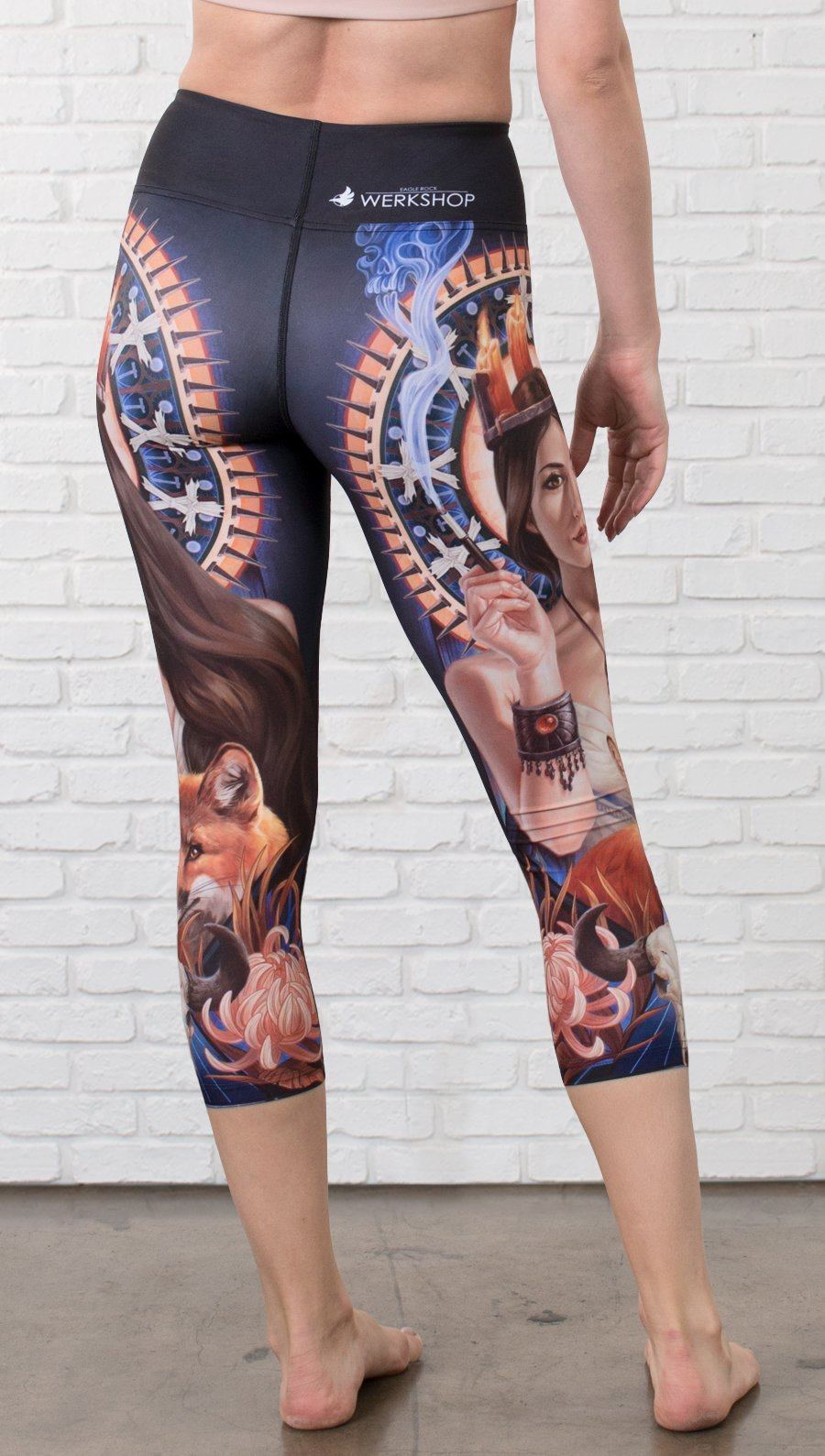 closeup left side view of model wearing capri leggings with witchcraft and fox theme
