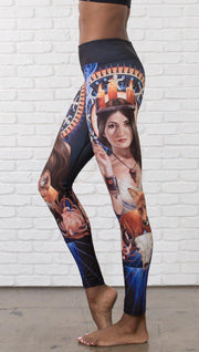 closeup left side view of model wearing full length leggings with Japanese witchcraft and fox theme