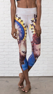 close up front view of model wearing witch death and skull themed printed capri leggings