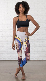 front view of model wearing witch death and skull themed printed capri leggings