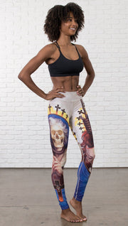 front view of model wearing witch death and skull themed printed full length leggings