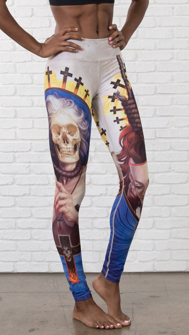 close up front view of model wearing witch death and skull themed printed full length leggings