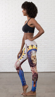 left side view of model wearing witch death and skull themed printed full length leggings
