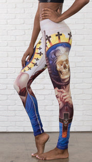 close up left side view of model wearing witch death and skull themed printed full length leggings
