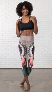 front view of model wearing capri leggings with Original Sin snake witchcraft theme