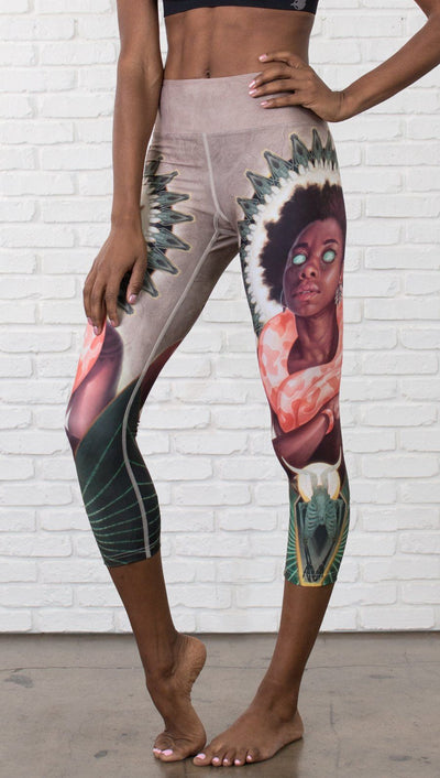 closeup front view of model wearing capri leggings with Original Sin snake witchcraft theme