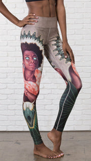 closeup front view of model wearing full length leggings with Original Sin snake witchcraft theme