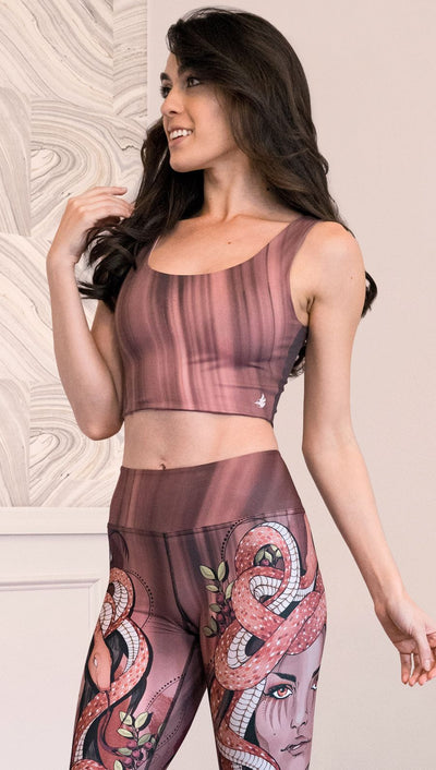 Model wearing a mauve color sleeveless crop top with black brushstrokes