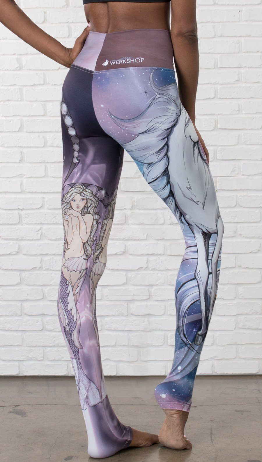 closeup front view of model wearing full length leggings with unicorn and mermaid mashup printed design