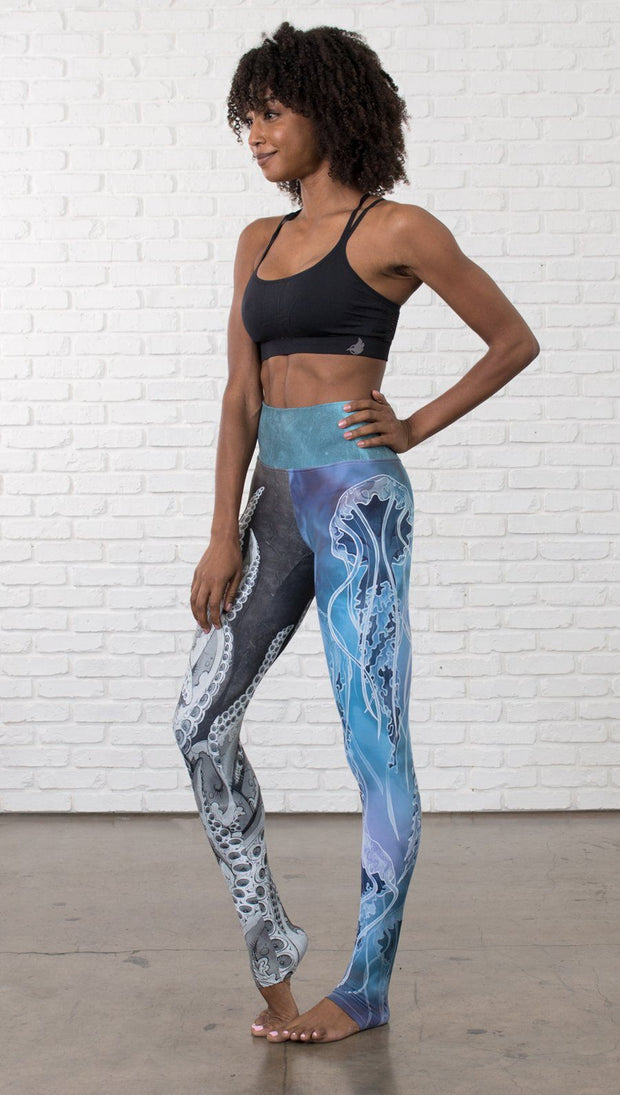 front view of model wearing ocean themed tentacles and jellyfish mashup design printed full length leggings