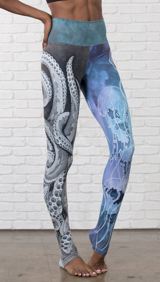 closeup front view of model wearing ocean themed tentacles and jellyfish mashup design printed full length leggings