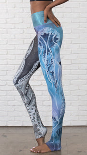 closeup left side view of model wearing ocean themed tentacles and jellyfish mashup design printed full length leggings