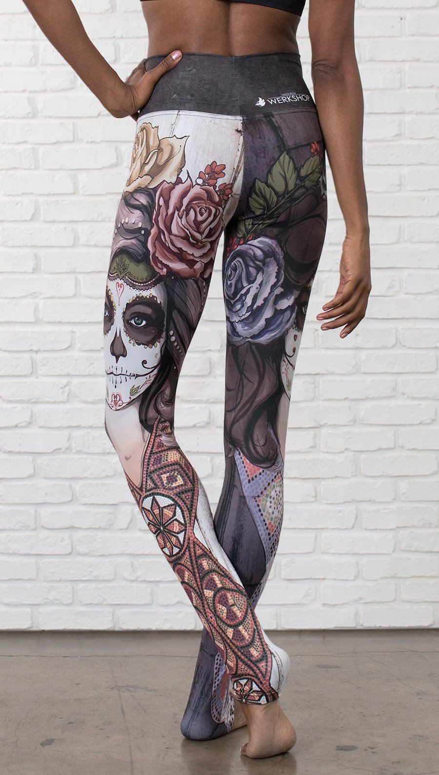 closeup front view of model wearing mashup Sugar Skull and Dia De Los Muertos themed printed full length leggings