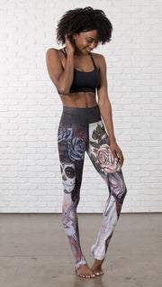 front view of model wearing mashup Sugar Skull and Dia De Los Muertos themed printed full length leggings