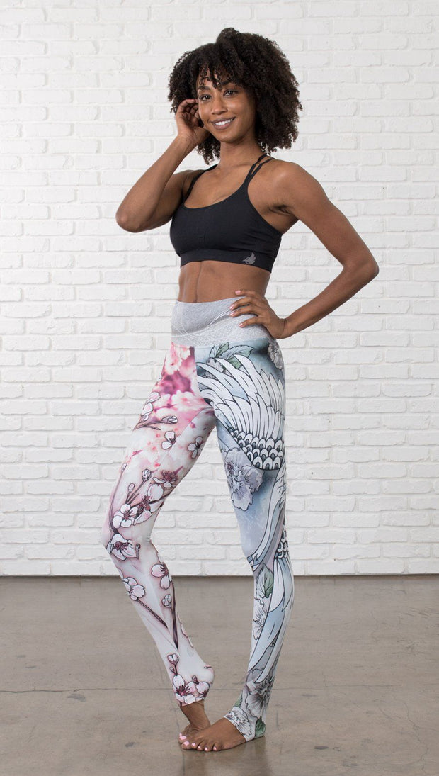 front view of model wearing Cherry Blossom, Swooping Crane and Koi Fish themed printed full length leggings