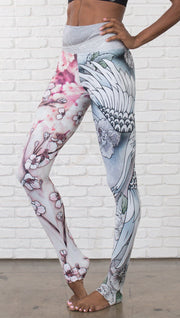 closeup left side view of model wearing Cherry Blossom, Swooping Crane and Koi Fish themed printed full length leggings