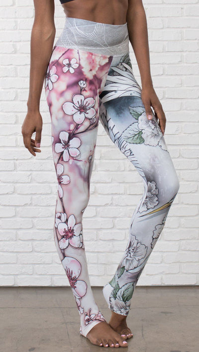 closeup front view of model wearing Cherry Blossom, Swooping Crane and Koi Fish themed printed full length leggings