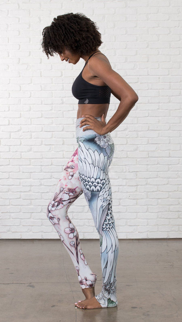 left side view of model wearing Cherry Blossom, Swooping Crane and Koi Fish themed printed full length leggings