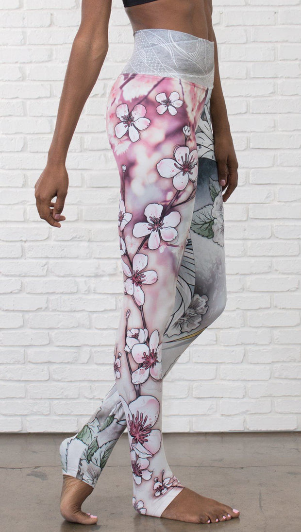 closeup right side view of model wearing Cherry Blossom, Swooping Crane and Koi Fish themed printed full length leggings