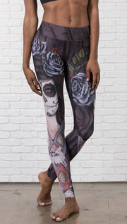 close up front view of model wearing sugar skull themed printed full length leggings