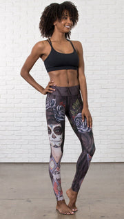 front view of model wearing sugar skull themed printed full length leggings