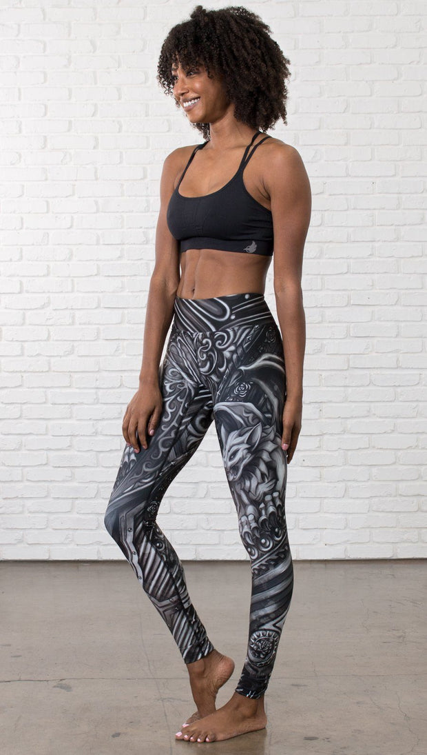 front view of model wearing galaxy themed printed full length leggings