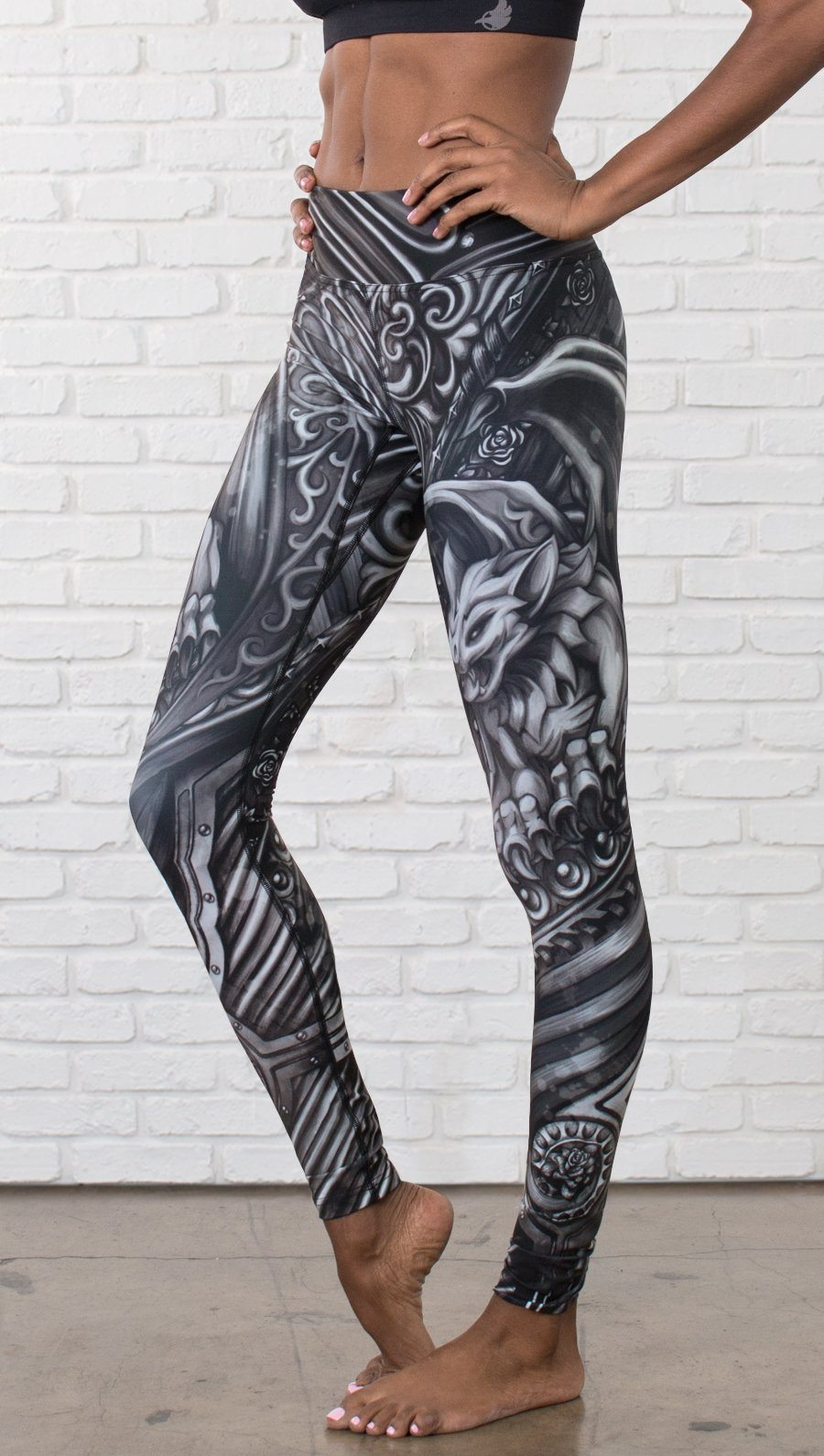 closeup front view of model wearing galaxy themed printed full length leggings