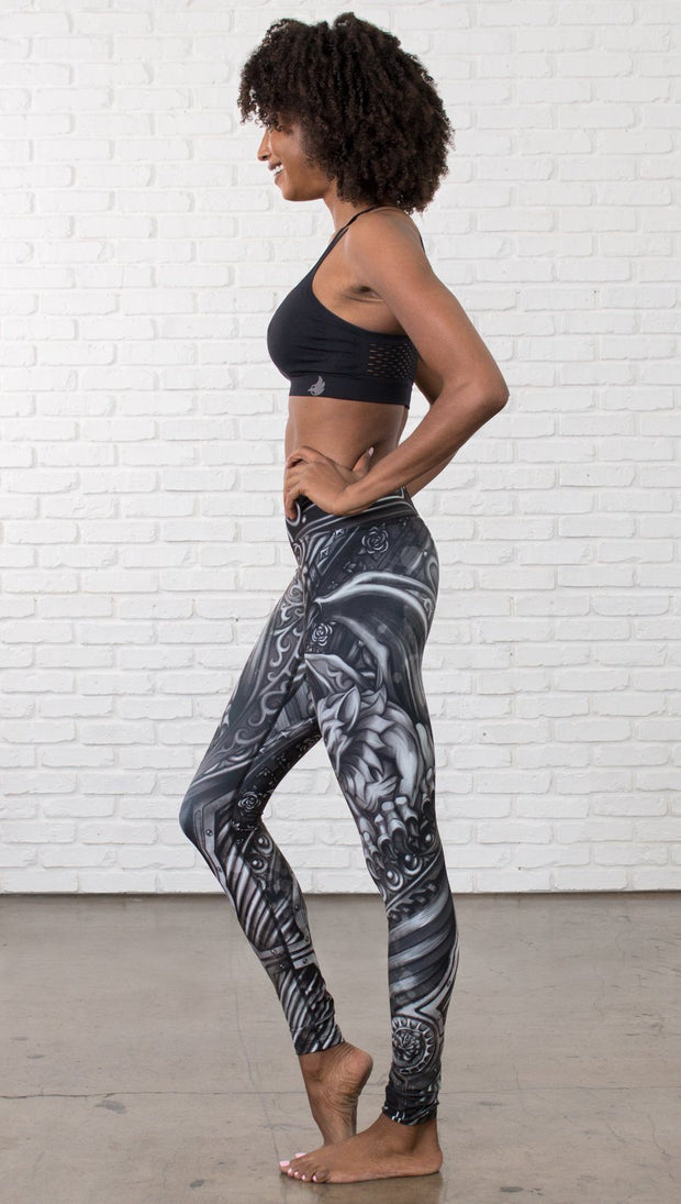 left side view of model wearing galaxy themed printed full length leggings