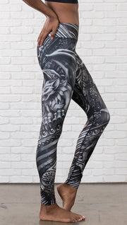 closeup right view of model wearing galaxy themed printed full length leggings