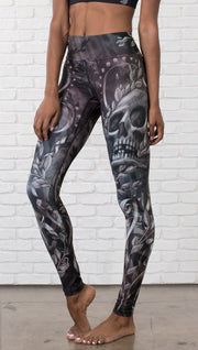 close up front view of model wearing gothic themed printed full length leggings