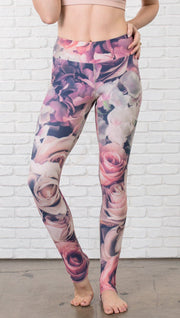 close up front view of model wearing romantic flower printed full length leggings