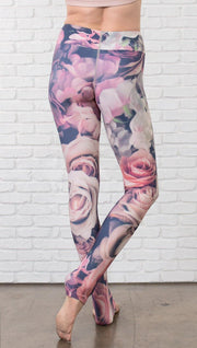 close up back view of model wearing romantic flower printed full length leggings