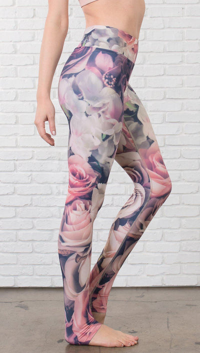 close up right side view of model wearing romantic flower printed full length leggings