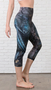 closeup right side view of model wearing gothic themed printed capri leggings