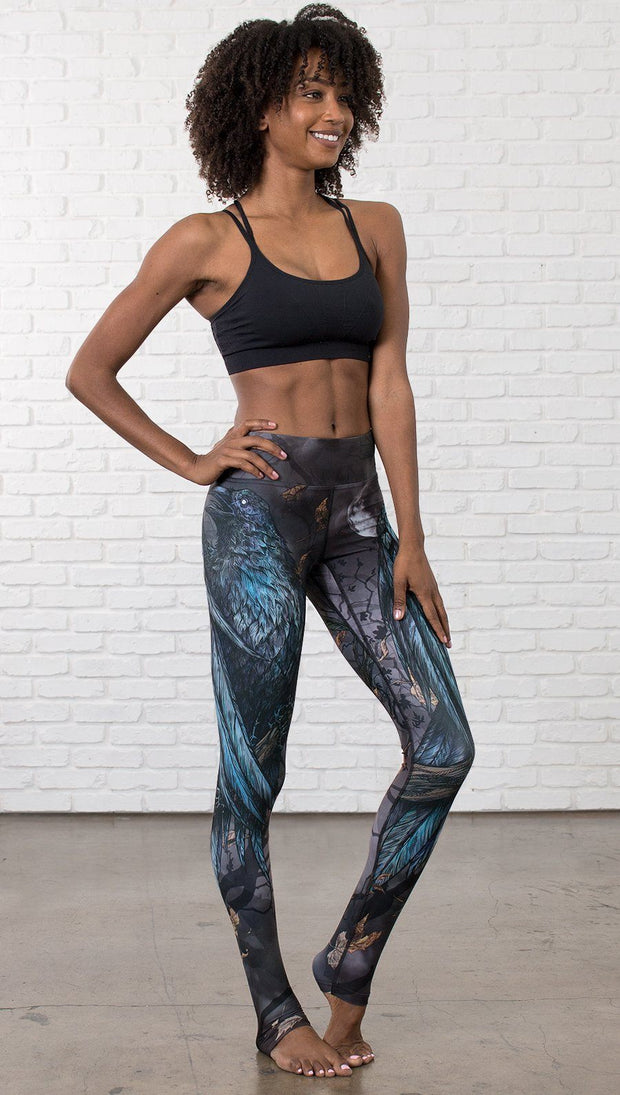 front view of model wearing gothic themed printed full length leggings