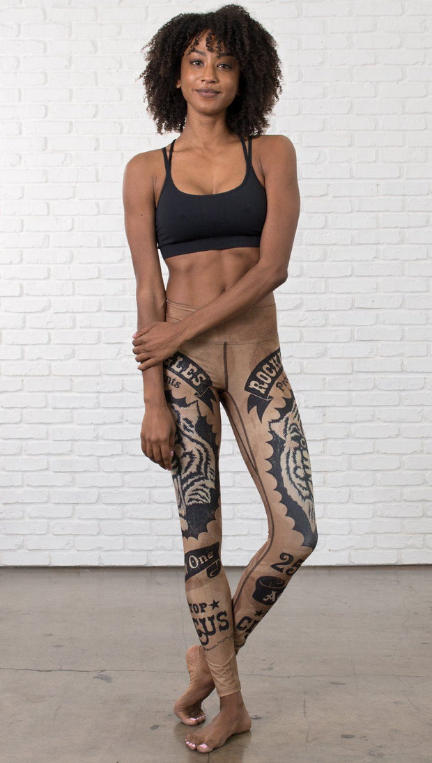 front view of model wearing vintage circus tiger printed full length leggings