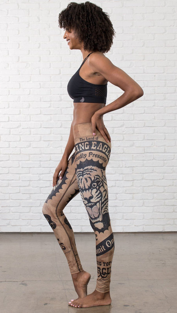 left side view of model wearing vintage circus tiger printed full length leggings