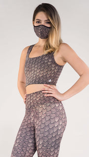Left side view of model wearing the Dragon/ Leopard top in the Dragon side in the color brown