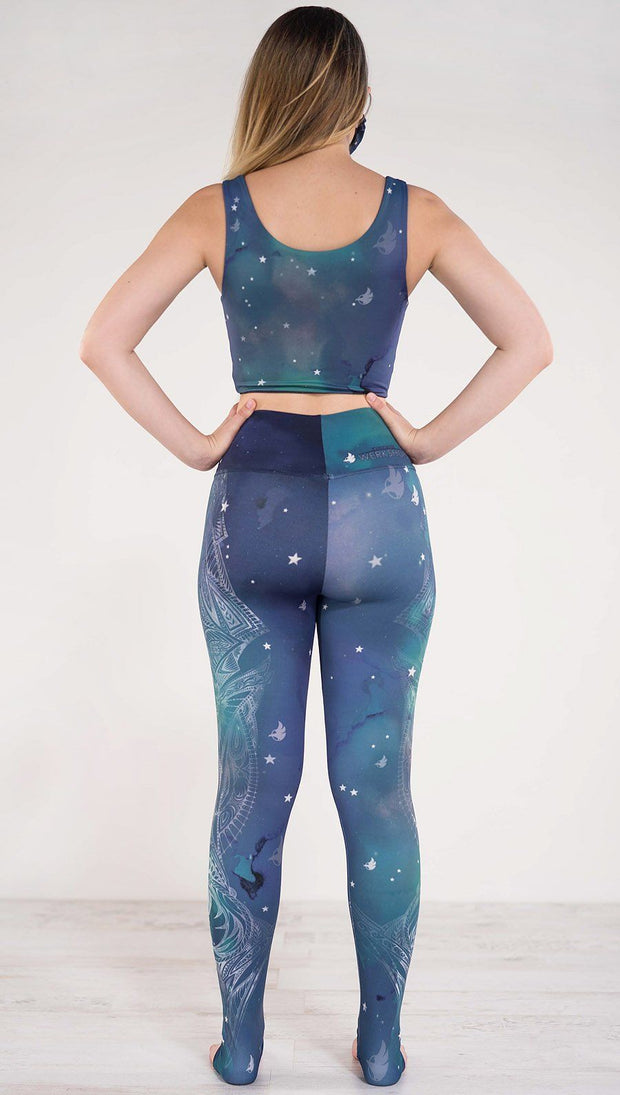 Back view of model wearing a blue and green galaxy themed athleisure leggings